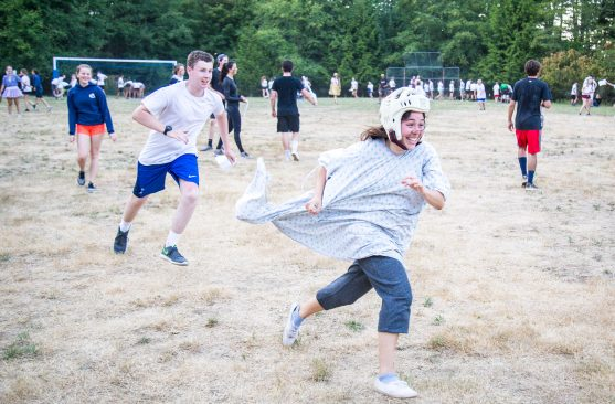 Campers chase each other during sports match