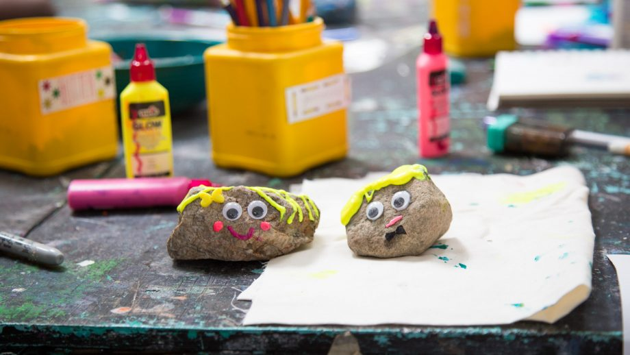 Decorated rocks on summer camp table
