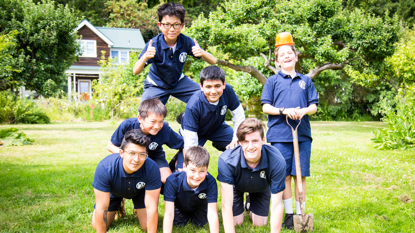 Boys cabin group forms pyramid