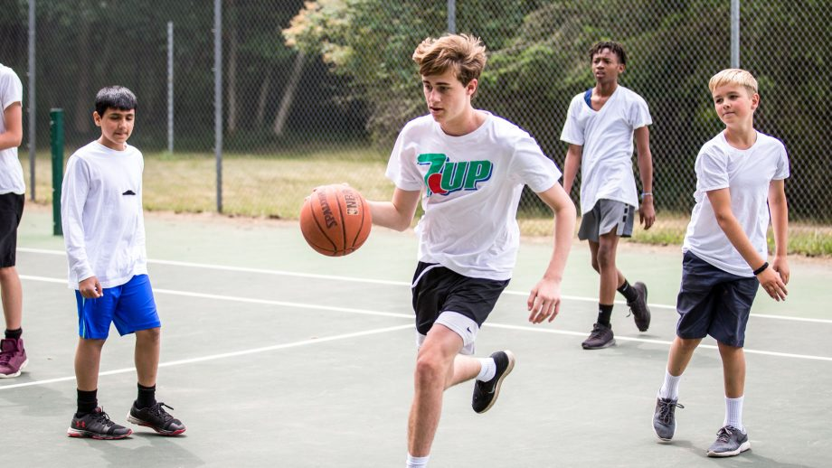 Camper dribbles basketball during game