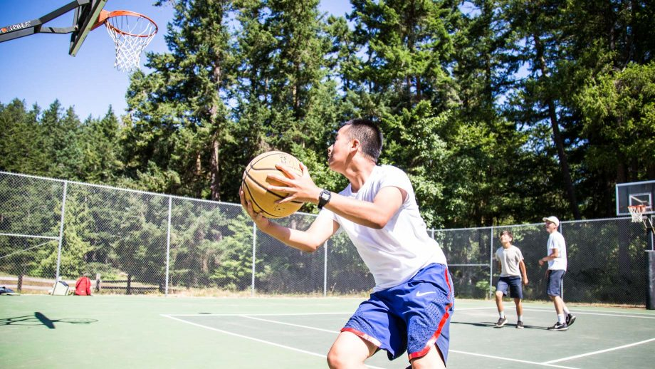 Camper shoots basketball during game