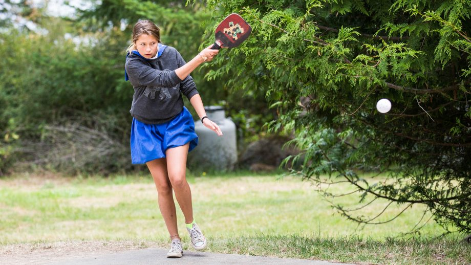 Camper returns ball during pickle ball