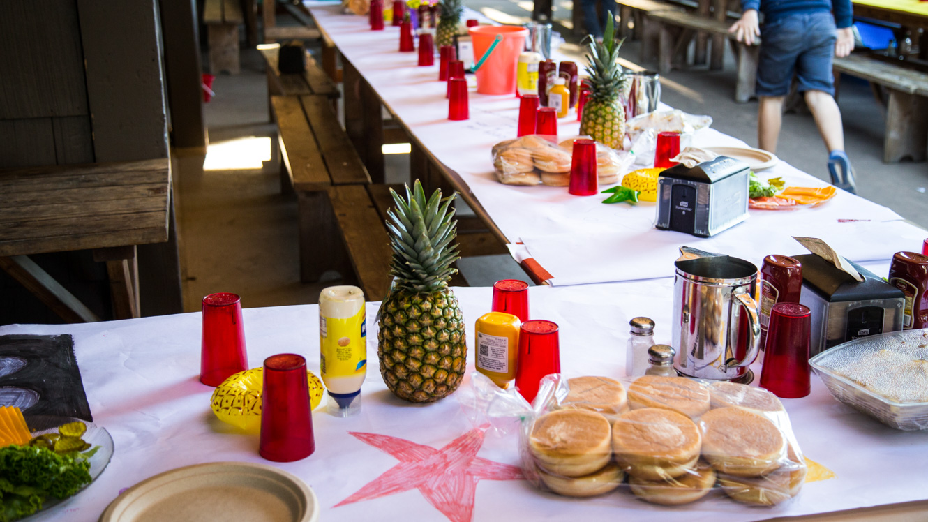 Table set with hamburger ingredients