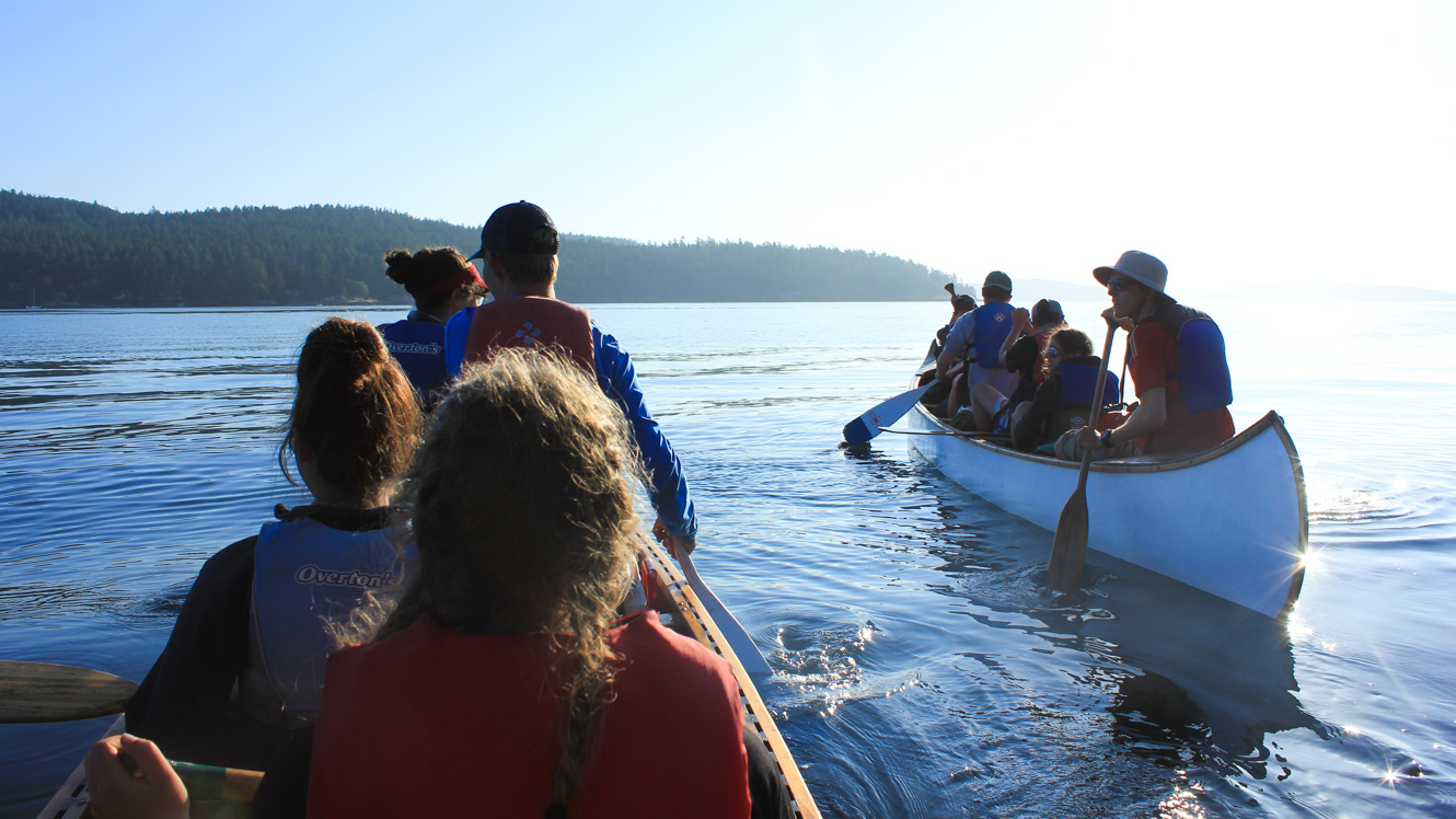 Group of campers canoes on out-of-camp trip