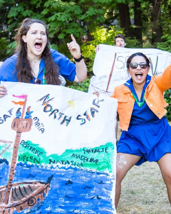 Counselors cheer for their campers on Arrival Day
