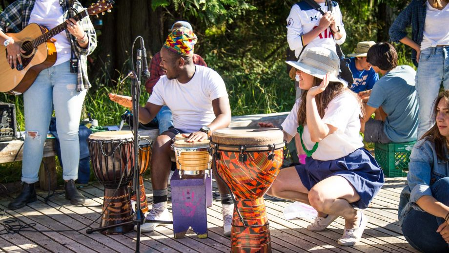 Staff plays drums for dancing