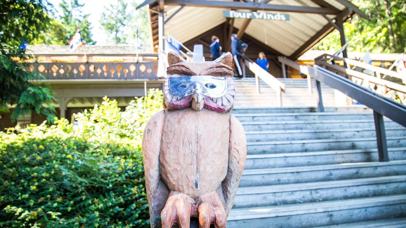 Owl statue with mask outside Four Winds lodge