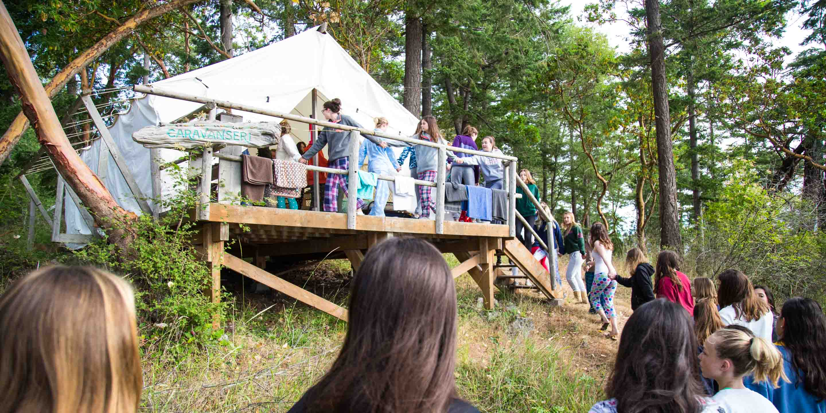 Campers form line into canvas tent on Gypsy Day