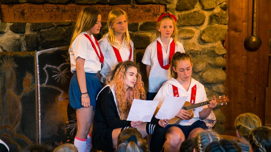 Group of campers perform song