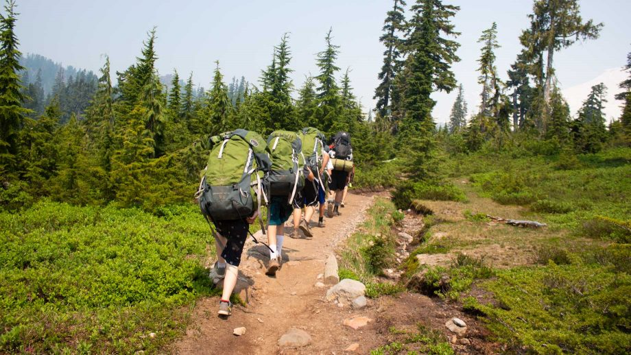 Backpacking group hikes trail