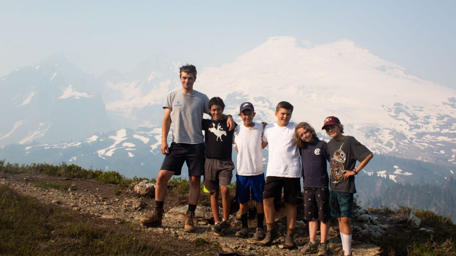 Campers take group photo on mountain trail