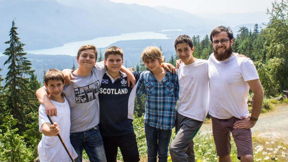 Campers stop for group photo on hike