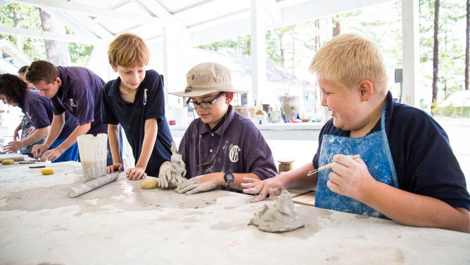 Campers work with clay at summer camp