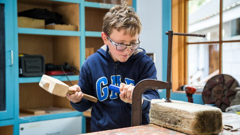 Camper does woodworking at summer camp