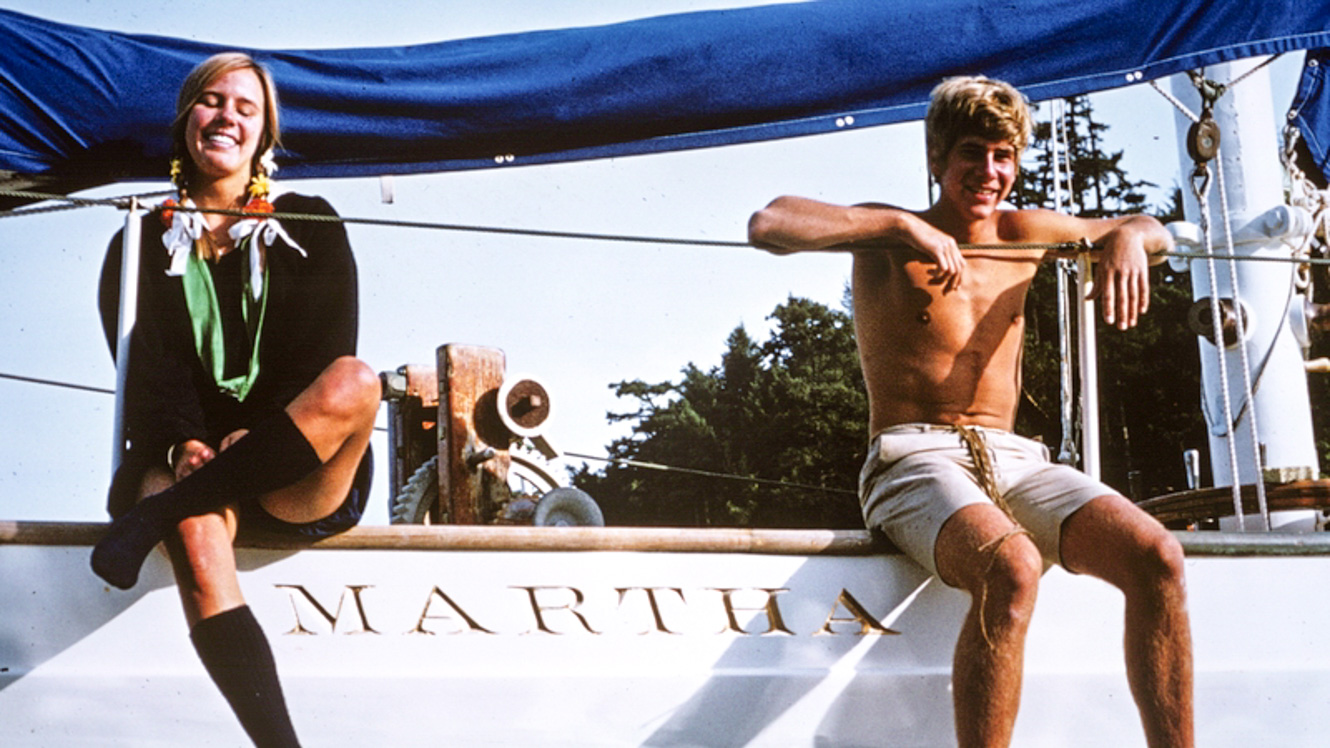 1970s campers sit on edge of Martha sailboat