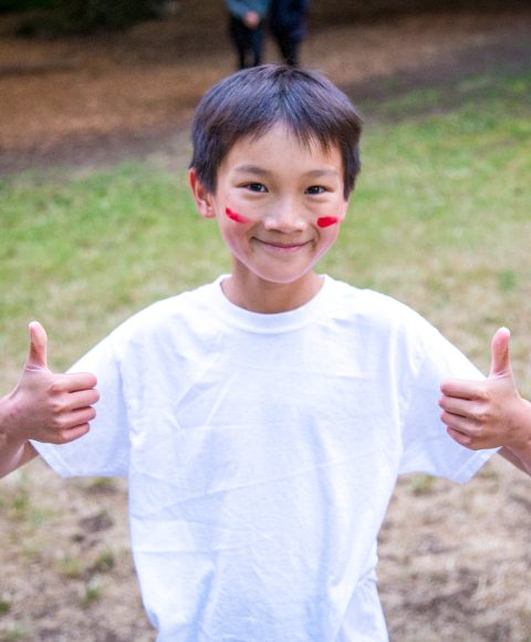 Smiling camper gives thumbs up