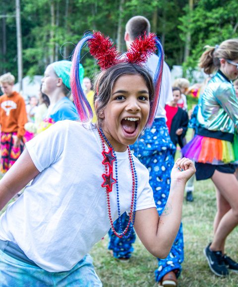Excited camper wears Independence Day pigtails